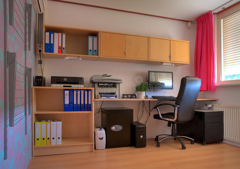 Home office. Workspace in a home office. The clothes horse at the left clearly indicates the concept of a home royalty free stock photos