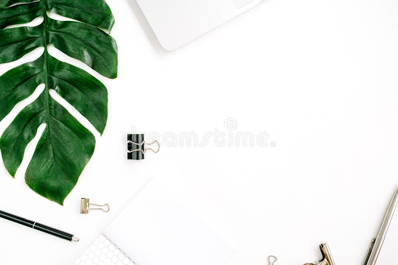 Home office workspace frame with laptop, palm leaf and accessories stock photos