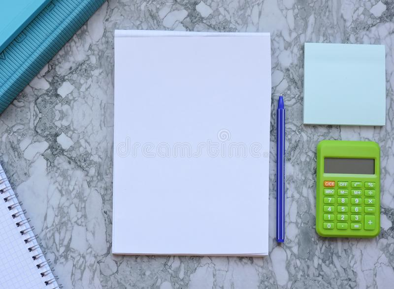 Home office workspace mockup.Workspace top view, copy space.White desk office with blank notebook,pencil and other office supplies royalty free stock photo