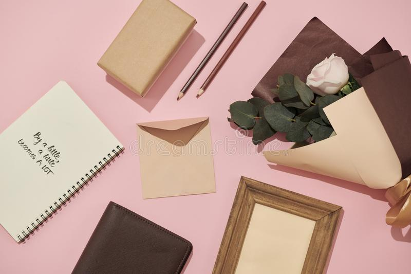 Home office workspace. Notebook with copyspace. Flat lay, magazines, social media. Top view Beauty blog concept. Woman fashion. Accessories on pink background stock photos