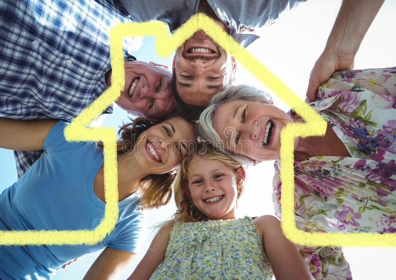 Home outline with multi generation family standing in background royalty free stock image