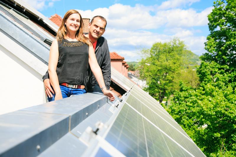Home Owners Are Happy With Solar Panels On His Roof royalty free stock image