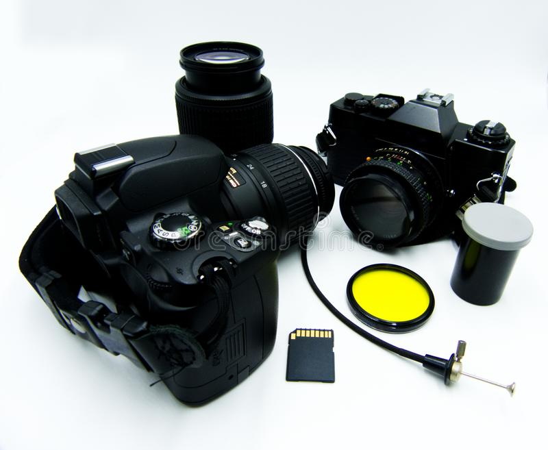 Home photo studio, digital and analog cameras compared, white background. Home photo studio, digital and analog cameras compared royalty free stock image