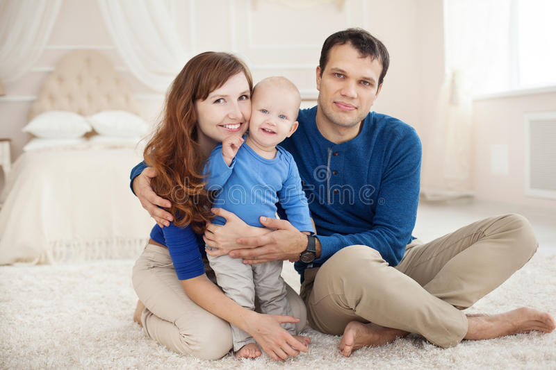 Home portrait of happy young family. royalty free stock photography