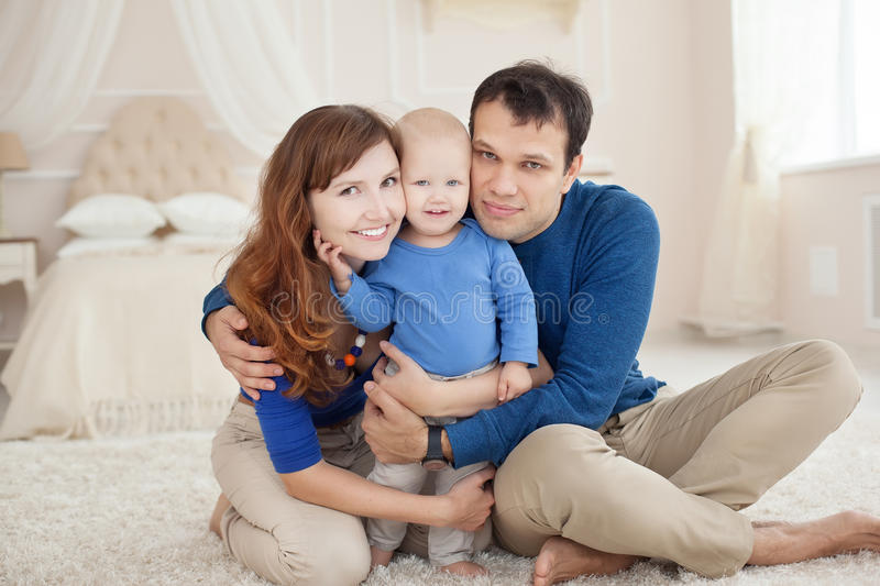 Home portrait of happy young family. royalty free stock images