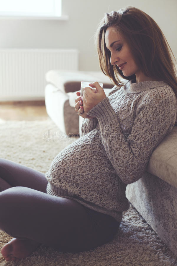 Home portrait of pregnant woman stock photography