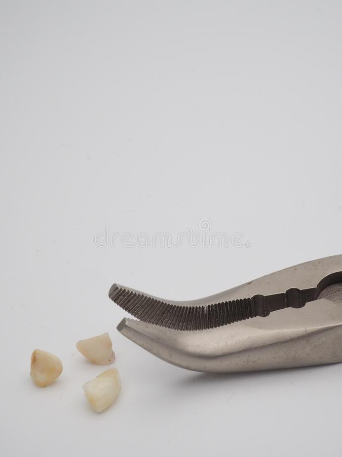 Home pulled teeth with pliers stock photo