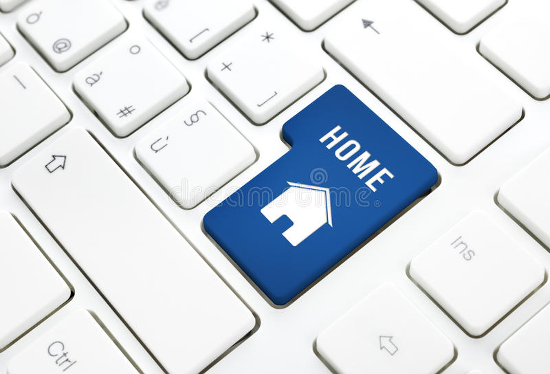 Home or real estate concept, blue house enter button or key on a keyboard. Home or real estate concept, blue house enter button or key on white keyboard royalty free stock photos