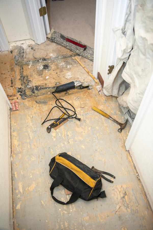 Home Remodeling, Kitchen Floor, Flooring. Home kitchen remodeling construction project. A house is getting a new floor. Plywood install is a subfloor. Sub floors royalty free stock photos