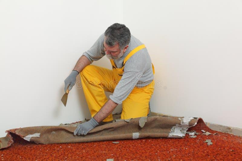 Home renovation, carpet remove stock photos