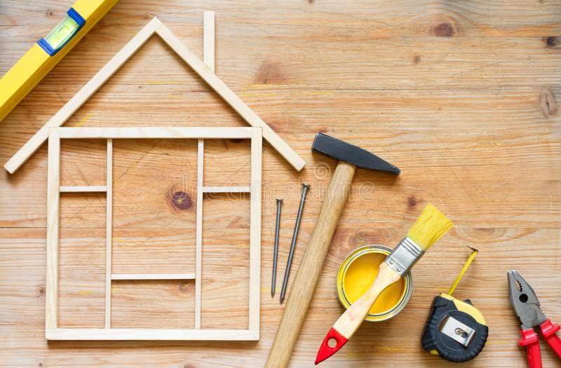 Home renovation construction diy abstract background with tools on wooden board. Closeup royalty free stock photography
