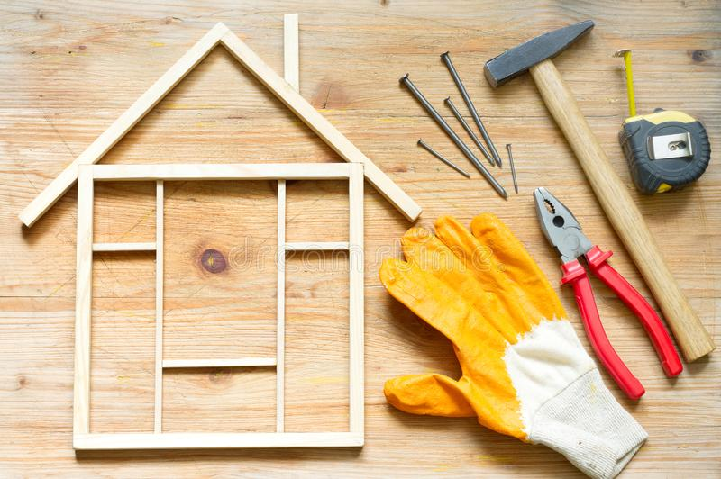 Home renovation construction diy abstract background with tools on wooden board. Closeup stock photography