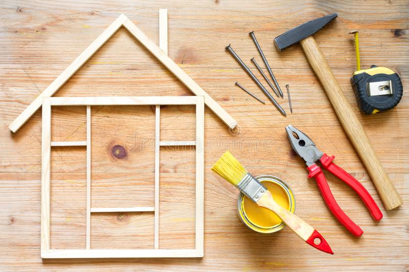 Home renovation construction diy abstract background with tools on wooden board. Closeup stock images
