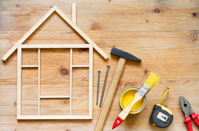 Home renovation construction diy abstract background with tools on wooden board. Closeup royalty free stock photo