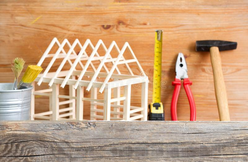 Home renovation construction diy abstract background with tools on wooden board. Closeup royalty free stock images