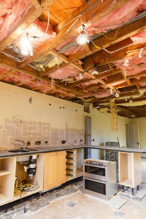 Home renovation remodeling. Home renovation scene with a kitchen ceiling ripout prior to a refurbishment and kitchen fitting royalty free stock photos