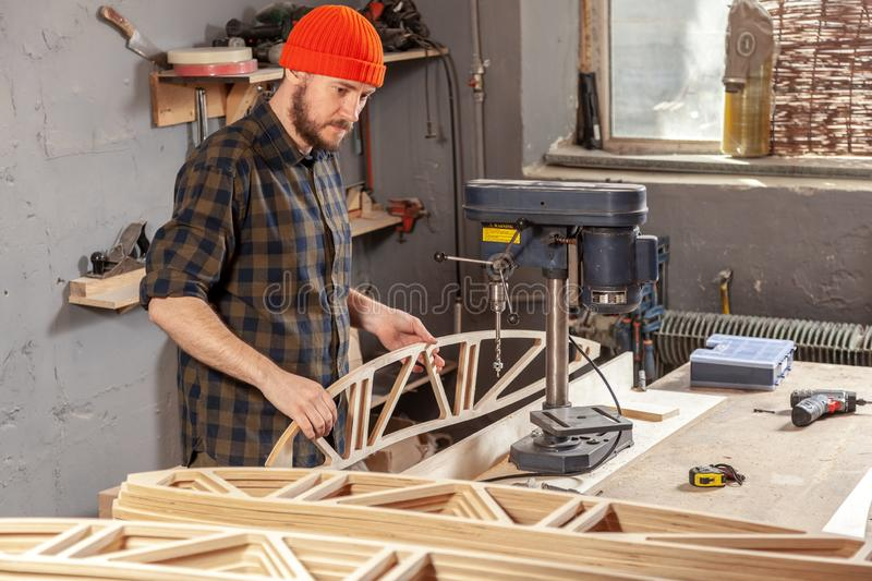 Home repair concepts. Construction Worker Using Drill To wood. Drill machine on the table in renovation work at home. Home repair concepts, close up stock image