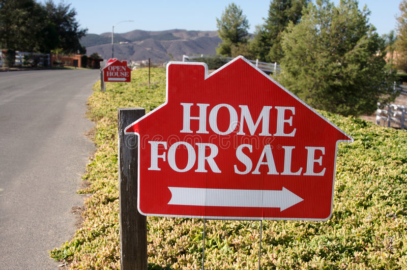 Home For Sale Sign. Along a rural street stock photography
