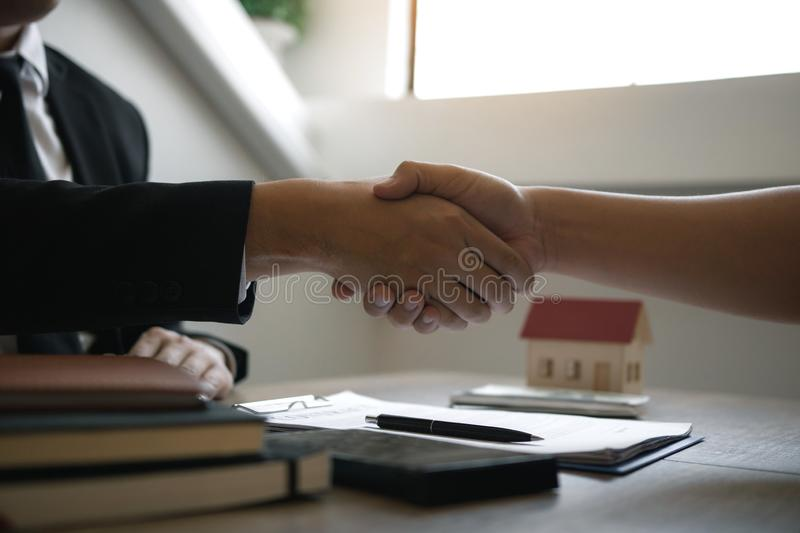 Home sales agents and buyers work on signing new homes and shaking hands.  stock photos