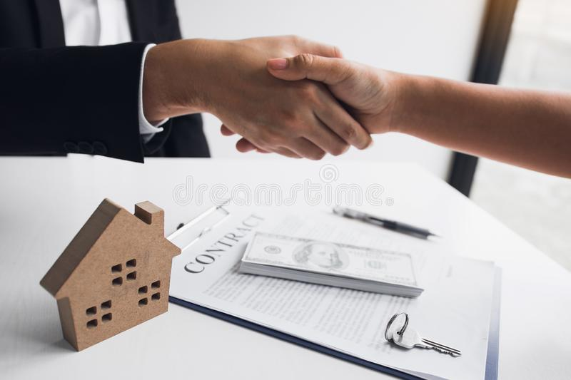 Home sales agents and buyers work on signing new homes and shaking hands.  royalty free stock photos