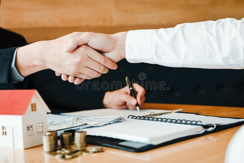Home sales agents and buyers work on signing new homes and shaking hands.  stock image