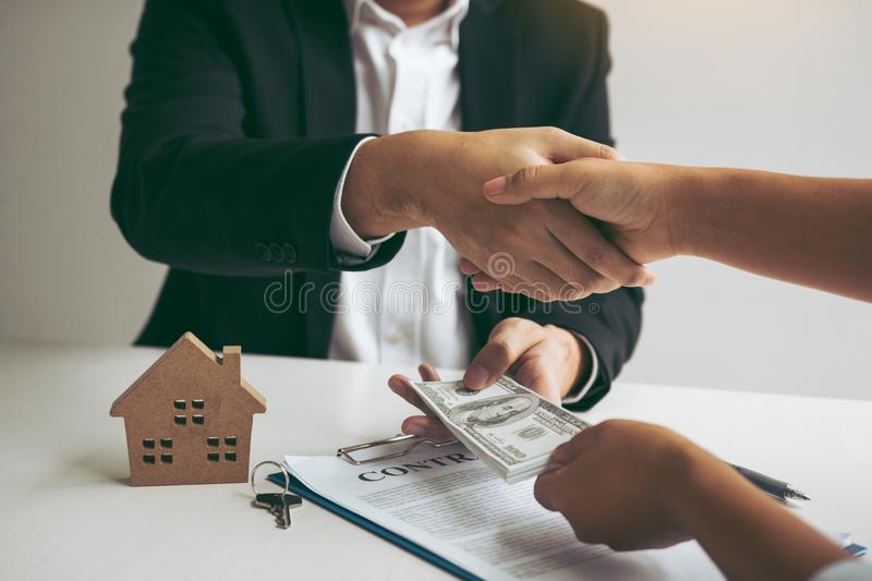 Home sales agents and buyers work on signing new homes and shaking hands.  royalty free stock photography