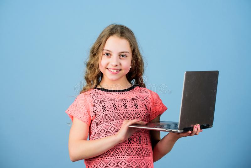 Home schooling education. child development in digital age. play computer games. shopping online. school project. Startup business. happy little girl with stock photos