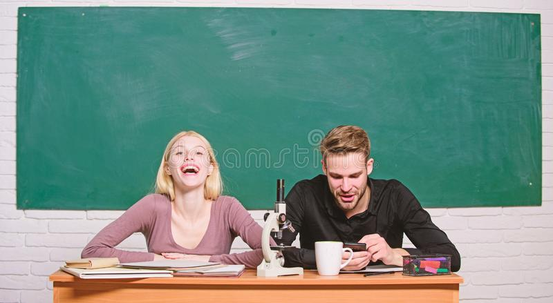 Home schooling. Modern school. Knowledge day. Couple of man and woman in classroom. Back to school. Student life. Lesson. Home schooling. Modern school royalty free stock photo