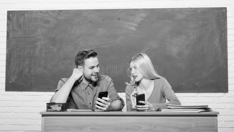 Home schooling. Modern school. Knowledge day. Couple of man and woman in classroom. Back to school. Student life. Lesson. Home schooling. Modern school stock image
