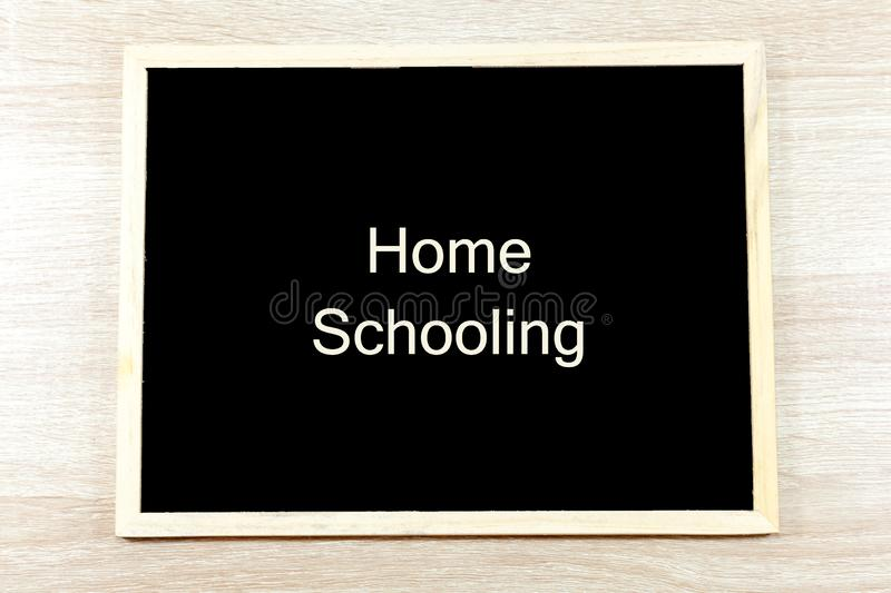 Home Schooling text on blackboard with frame royalty free stock photography