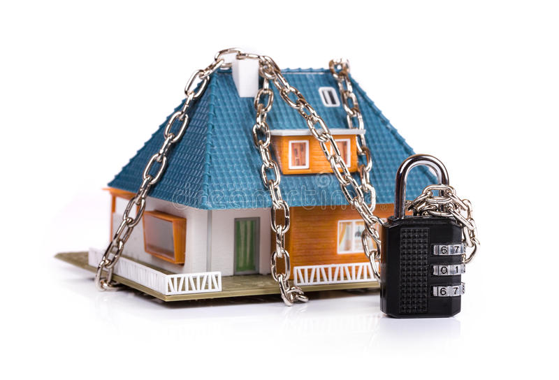 Home security concept - chain with padlock around the house stock photos