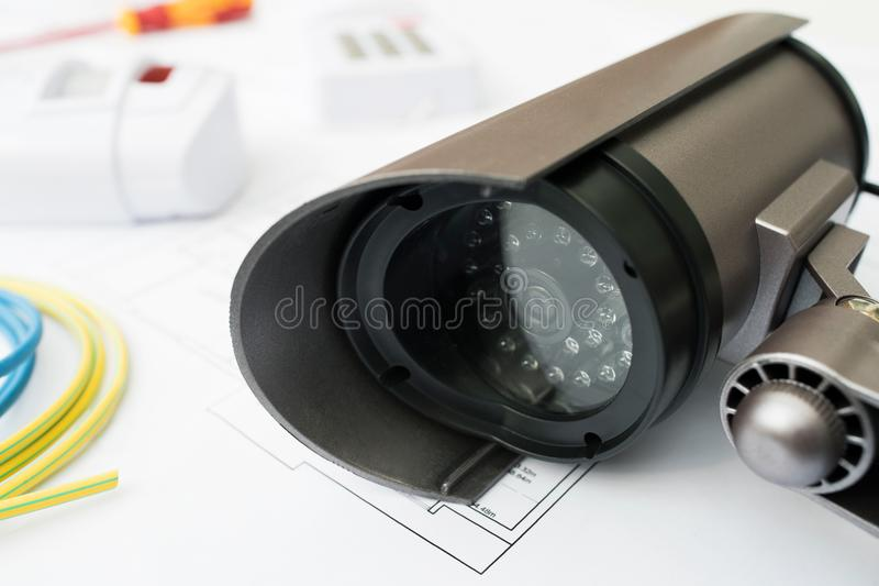 Still Life Of Home Security Products Arranged On House Plans. Home Security Products Arranged On House Plans stock photo