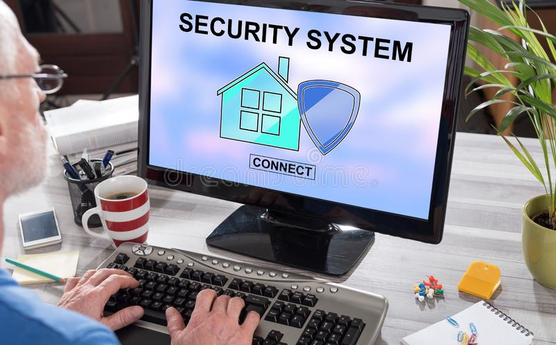 Home security system concept on a computer. Man using a computer with home security system concept on the screen stock photos
