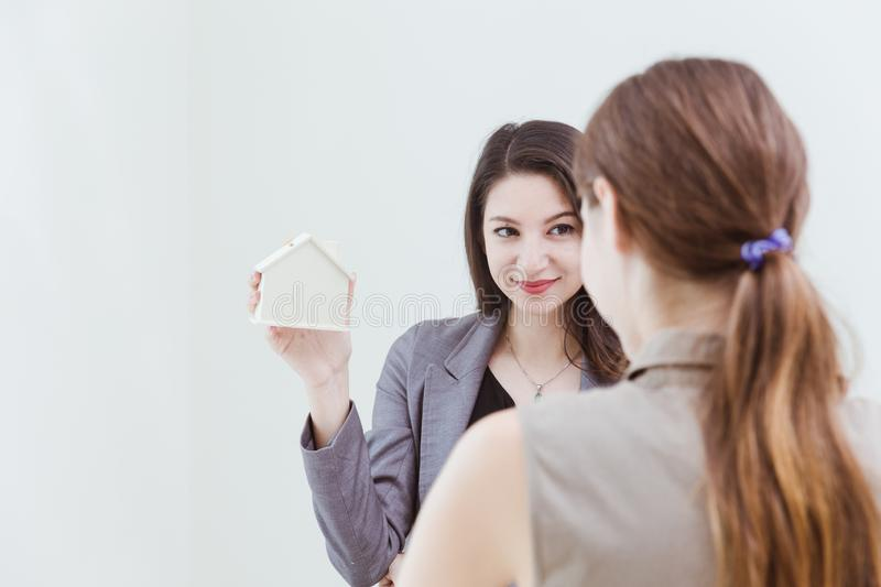 Home selling agency present offer new house to buyer for making decision royalty free stock image