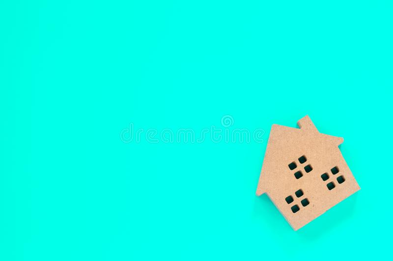 Home shape wood. Model on blue background, concepts for real estate and business royalty free stock photo