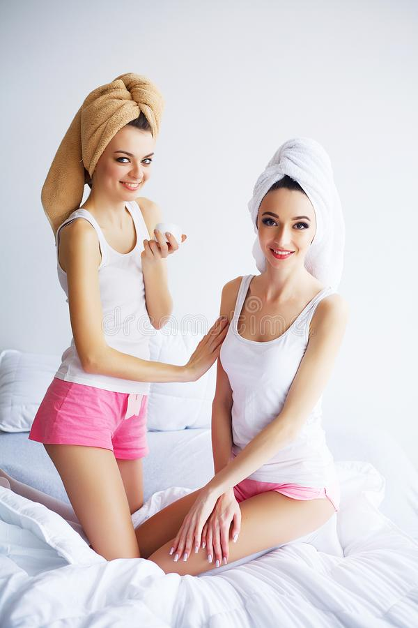 Home spa beauty pure clean skin care women applying facial homemade mask.  stock images