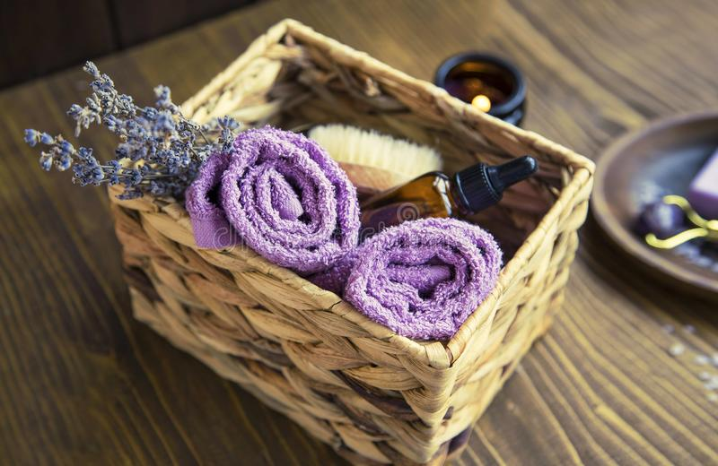 Lavender spa composition, home spa day with lavender products, top view of spa still life towels, lavender oil, natural soap, bath. Home spa day with lavender royalty free stock image