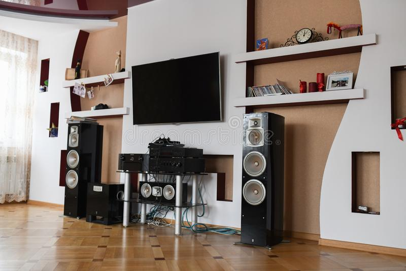 Home speaker system. Modern Home Theater Room Interior with Flat Screen TV.  stock photos