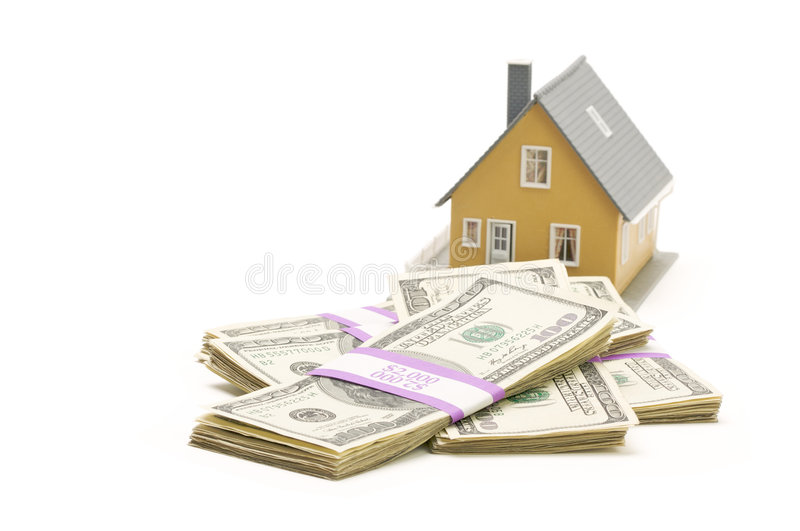 Home and Stacks of Money Isolated. On a White Background royalty free stock images