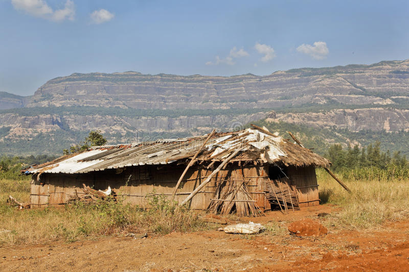 Home sweet home under Sahyadhri mountains. As much recycled materials or naturally regenerating materials have been used to create a home or cattle shed under stock photos