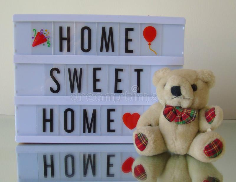 Home Sweet Home` Lightbox. Lightbox with words `home sweet home` and teddy bear stock photo