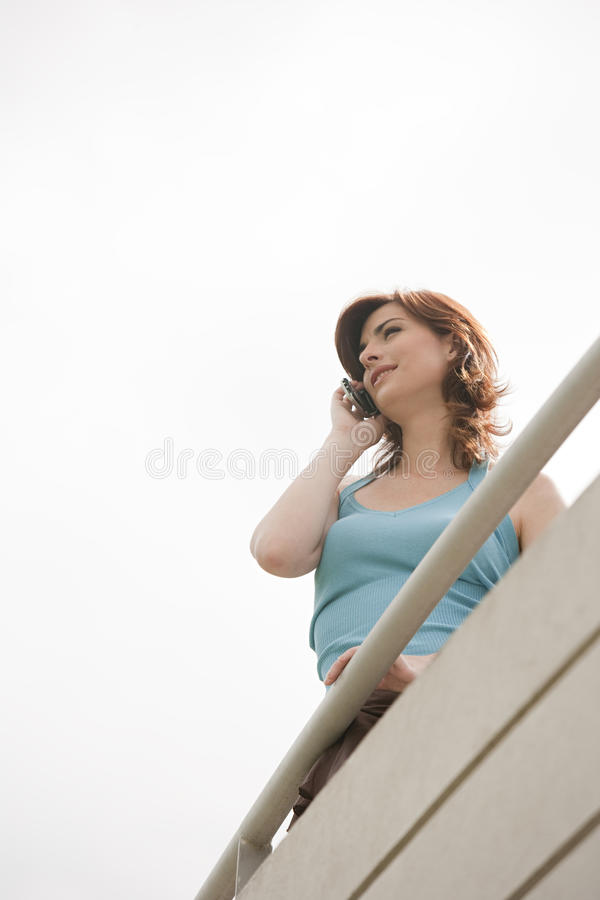 Home Tech Woman On Balcony Smiling Stock Photography