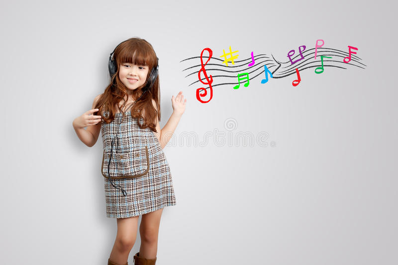 Home, technology and music concept - little girl with headphones stock photo