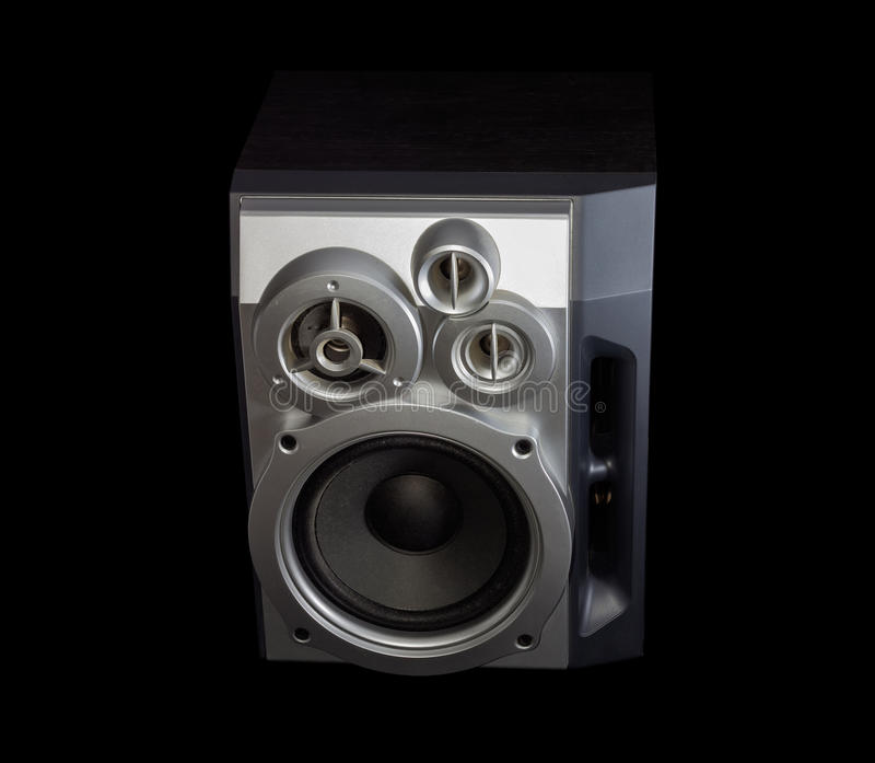 Home three-way loudspeaker system on a dark background. Home high fidelity three-way loudspeaker system with bass reflex port in silvery housing on a dark royalty free stock photos