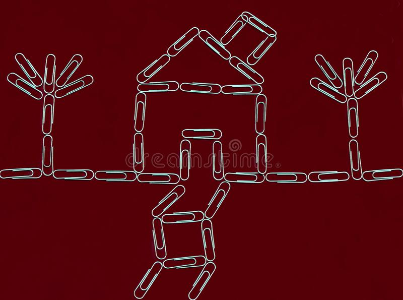 Home and trees with paper clips stock image