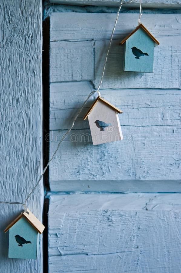 Home wall decoration with bird houses on blue royalty free stock photo