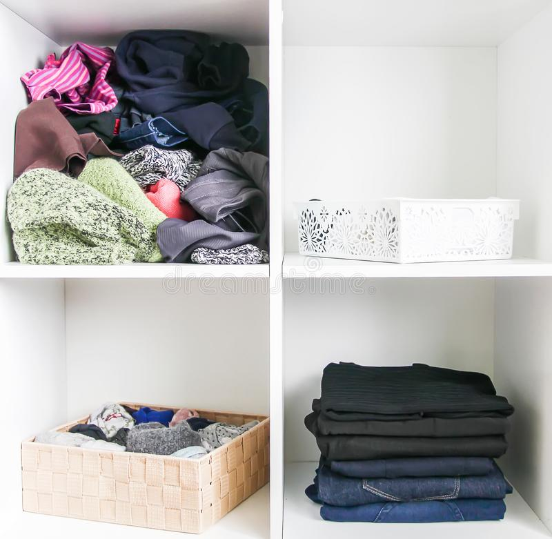 Home wardrobe with different clothes. Small space organization. The contrast of order and disorder royalty free stock photo