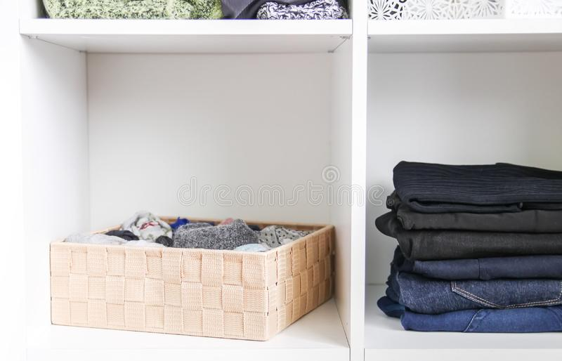 Home wardrobe with different clothes. Small space organization. The contrast of order and disorder royalty free stock photos