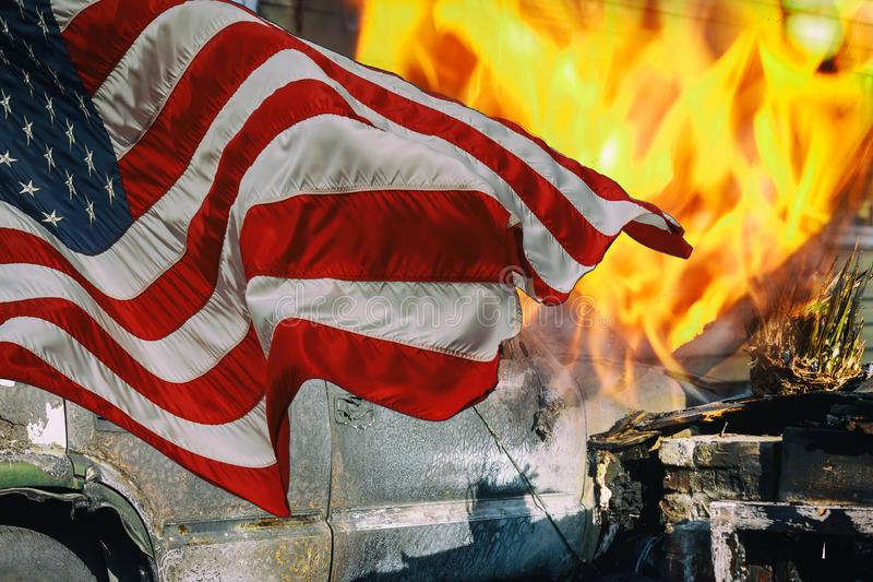 A home was burned by the homes were lost to the blaze and the American Flag royalty free stock image