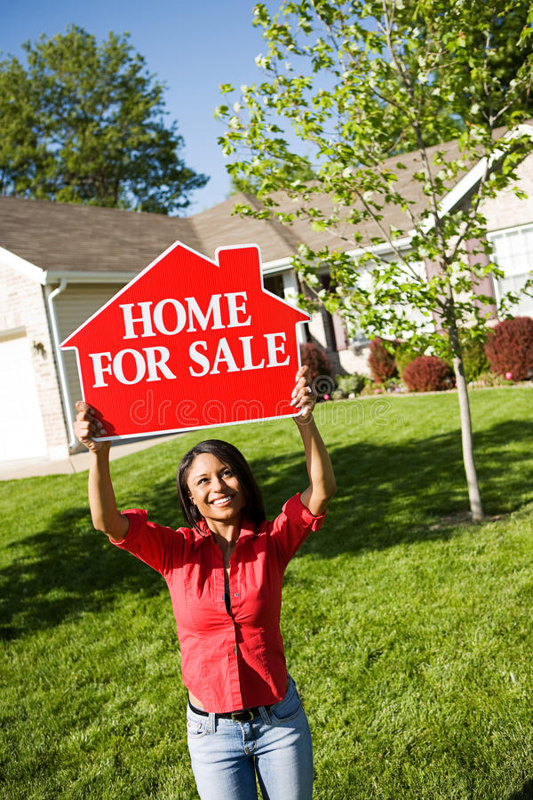 Home: Woman Holds Up For Sale Sign stock image